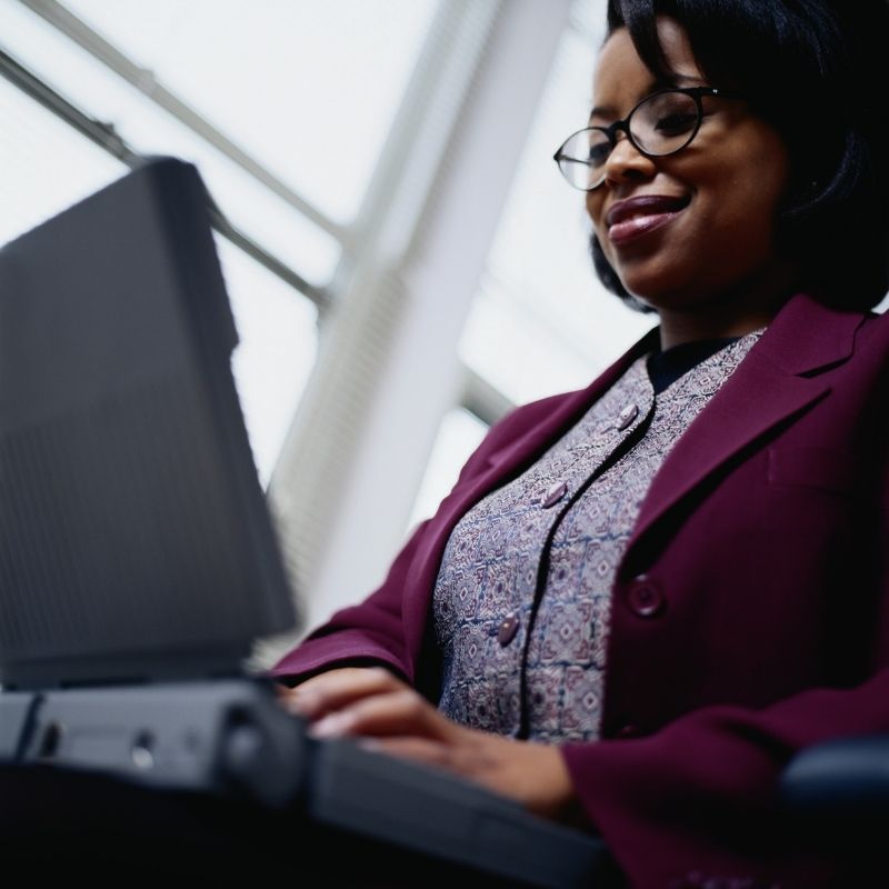 Black businesswoman typing on laptop